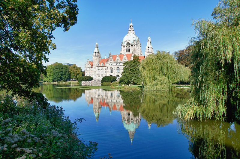 Panoramic view of the reflecting new town hall of hanover, germany