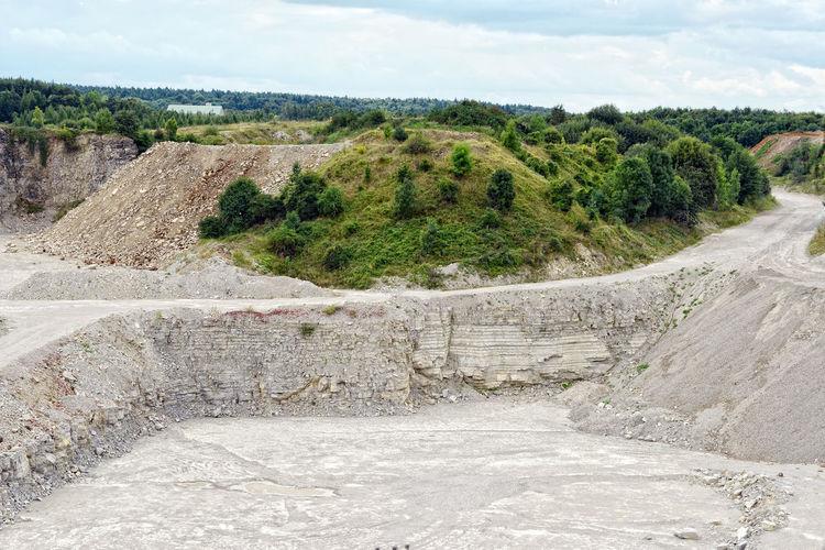 view into a limestone quarry (Germany), sedimentary rock. Bergbau Franconia Franken Limestone Mine Mining Nature No People Open Pit Mine Open Pit Mining Quarry Steinbruch