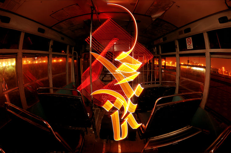 Abstract Light Graffiti or light painting using Arabic calligreaphy inside an abandon bus (using led lights and slow shutter photography) Arabic Calligraphy Bulgaria Bus Calligraffiti Calligraphy Fish Eye Illuminated Illuminated Signs Indoors  Industry Landscape Led Lights  Light Graffiti Light Painting Motion Light Night Perspective Public Transportation Seat Slow Shutter Transportation