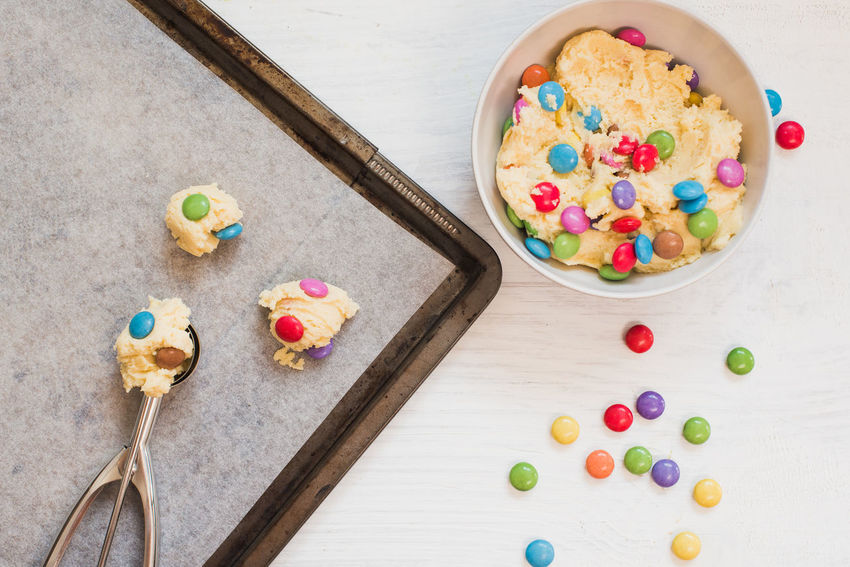 Cookie dough with colorful chocolate candies Chocolate Cookies Homemade Scooper Sugar Baking Chocolate Candies Chocolate Candy Cookie Dough Dough Dough Scooper Dough Scoops Dough Scraper Indulgence Scoop Scooping Dough Smarties Sugar Cookies