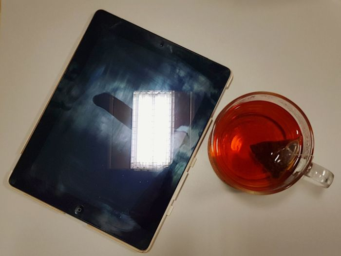 High angle view of tea in glass on table
