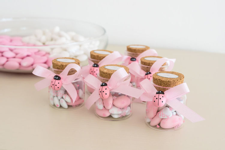 Confetti for christening day Art And Craft Creativity Ladybug Arrangement Christening Day Close-up Collection Confetti Focus On Foreground Food And Drink Large Group Of Objects No People Pink Color Representation Ribbon Ribbon - Sewing Item Still Life White