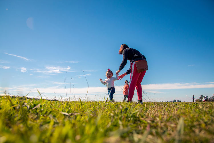 Outdoors Outdoors Photograpghy  Lifestyles Lifestyle Sky Real People Field Family Parent Land Plant Men Nature Togetherness Child Bonding Father Grass Family With One Child Males  Side View Positive Emotion Daughter Son
