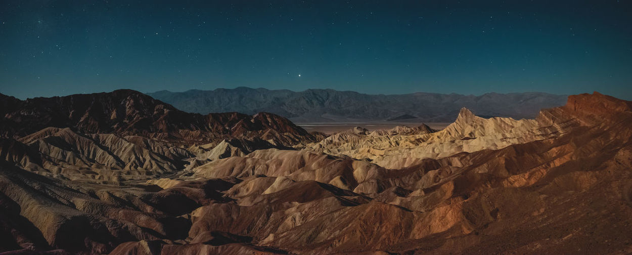 Zabriskie Point at Night ✨✨ Panorama long exposure night shot of the Amargosa Range seen from Zabriskie Point, Death Valley National Park, USA. Shot with Nikon D800E & Tamron 15-30mm lens. Dramatic Landscape Outdoors Formation Remote Rock Formation Solid Idyllic Rock - Object Nature No People Physical Geography Rock Mountain Range Sky Non-urban Scene Landscape Beauty In Nature Tranquility Mountain Tranquil Scene Scenics - Nature Zabriskie Point Night Nightsky Nightscape Stars Galaxy Long Exposure Panorama High Resolution Amargosa Range Death Valley Death Valley National Park California USA Roadtrip Travel Destination Mysterious Haunting  Eroded Sediments Bizarre Hiking Adventure Discover Places Iconic Landmark My Best Photo Wonders Of Nature Explore