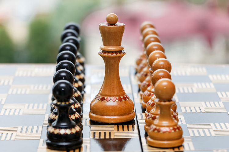 chess pieces on a chessboard Teamwork Symmetry Achievement Business Chess Player Chessboard Teamwork Win Achievements Battle Boss Businessman Checkmate Chess Chess Board Competition Decision Game Goal Play Chess Solution Strategy Success Team Ladder Of Success Colleague Board Game King - Chess Piece Royal Person First Place