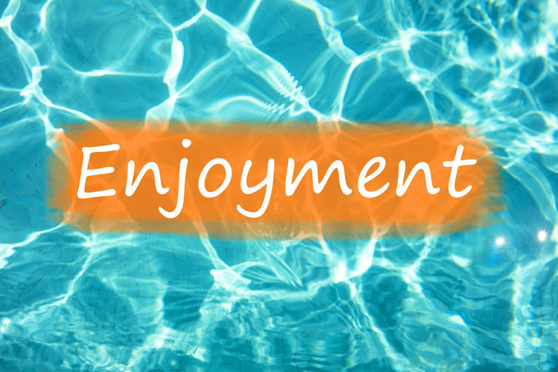 """Detail of word """"Enjoyment"""" on swimming pool water and sun reflecting on the surface. Freshness Fun Holiday Holidays Postcard Reflection Summertime Swimming Text Background Backgrounds Enjoying Life Enjoyment Enjoyments Enjoyment😁 Fresh Leisure Activity Relax Relaxation Summer Swimming Pool Wallpaper Water"""