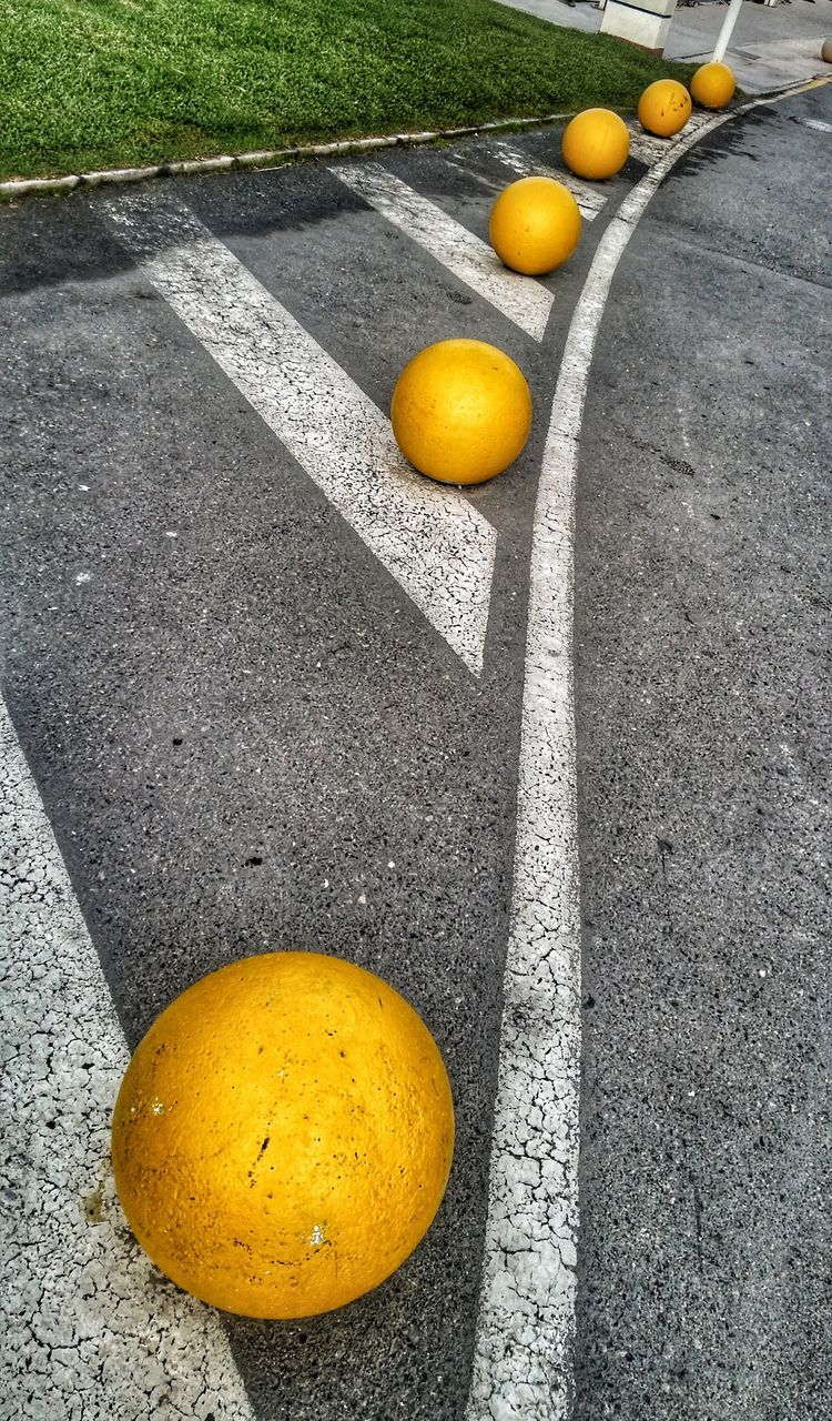 yellow, fruit, lemon, citrus fruit, orange - fruit, high angle view, outdoors, food, day, healthy eating, road, no people, freshness