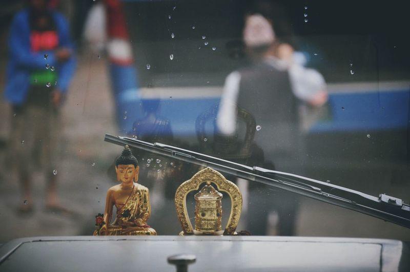 Close-up of metallic buddha in vehicle