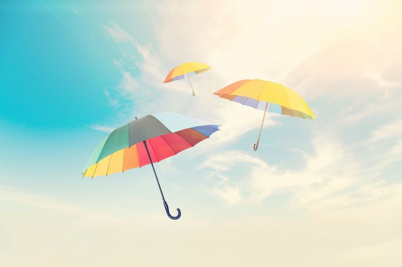 Umbrellas flying in the air Flying Sky Colourful Color Umbrella Sky Low Angle View Mid-air Flying Adventure Paragliding Extreme Sports