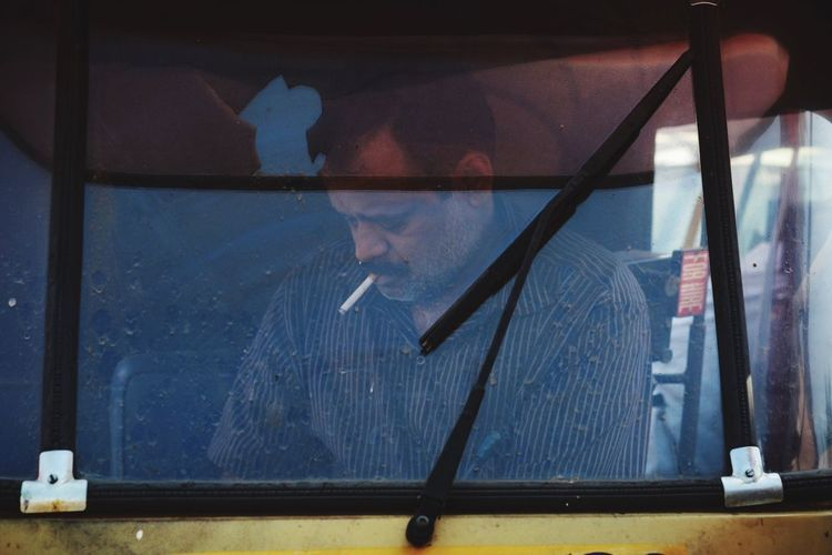 The Cigar Swag. Window One Person Transparent Real People Lifestyles Men Indoors  Day Occupation One Man Only Light And Reflection The Portraitist - 2018 EyeEm Awards