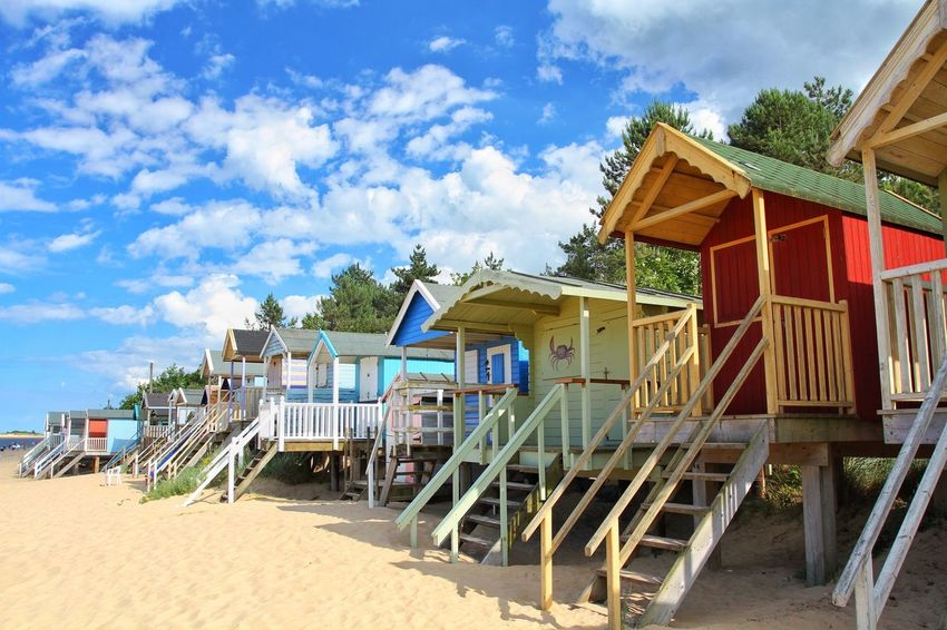 Colourful beach huts on stilts on the beautiful sandy beach of Holkham in Norfolk. Sand Beach Beachphotography Beach Huts Beach Photography Beach Life Beachlife Holkham Beach Wells-next-the-Sea Outdoors Travel Destinations Travel Norfolk Vacations Vacation Hut Huts Stilts Summer Summertime Built Structure No People Sky Sandy Rows