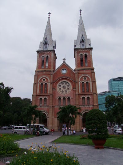 Notre Dame Church Architecture Building Exterior Built Structure Cathedral Church Cloudy Sky Composition Day Façade Flowers Full Frame Ho Chi Minh City Incidental People Outdoor Photography Outdoors Place Of Worship Red Brick Religion Saigon Spires Spirituality Tourism Tourist Attraction  Trees Vietnam