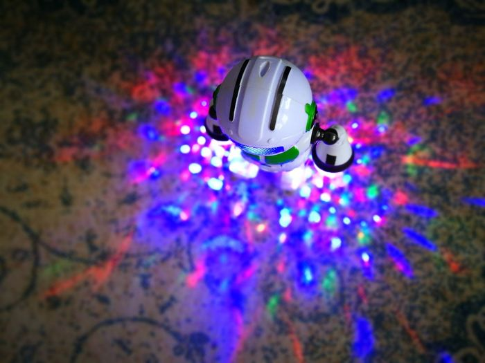 Multi Colored Colored Lights Robot Toy Robot Music Disco Ball Multi Colored Nightclub Arts Culture And Entertainment Nightlife Indoors  Disco Dancing Illuminated Clubbing Disco Lights Close-up Night Celebration