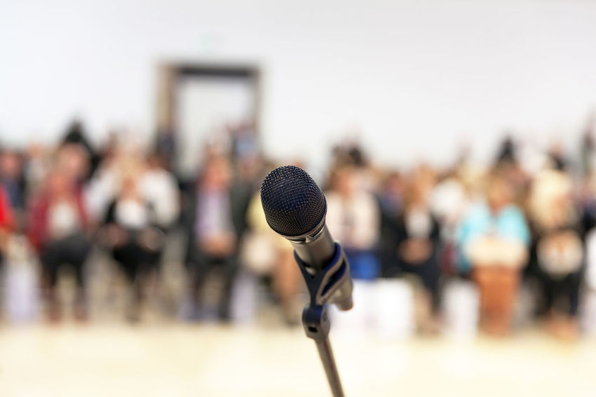 Presentation. Public speaking. Event Meeting Audience Auditorium Communication Conference Convention Crowd Large Group Of People Microphone People Politics Presentation Press Conference Public Speaker Speaking Speech