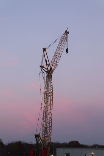 Construction Crane at Dusk Sky Machinery Architecture Crane - Construction Machinery Sunset Built Structure Low Angle View Nature No People Construction Industry Construction Site Development Tall - High Metal Outdoors Industry Technology Connection Dusk