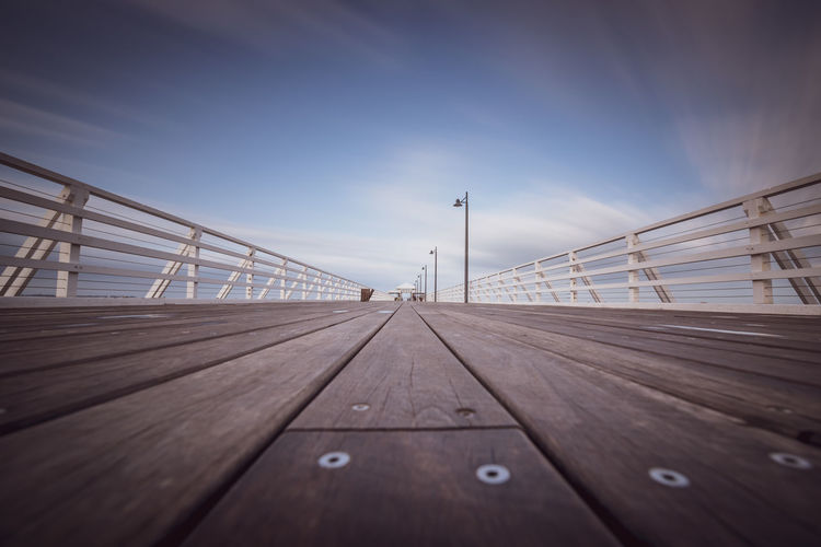 Surface Level Of Wooden Pier Against Sky