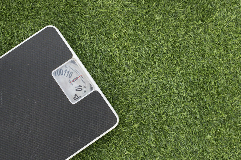 photo of a weighing scale on a green grass (lose weight concept) Grass Green Weighing Scale Close Up Conceptual Conceptual Photography  Fat Fitness Flat Lay Healthy Lifestyle High Angle View Lose Weight No People Numbers Shoes Sports Technology