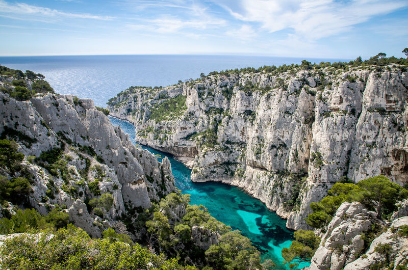 Scenic view of river flowing amidst mountains at cassis