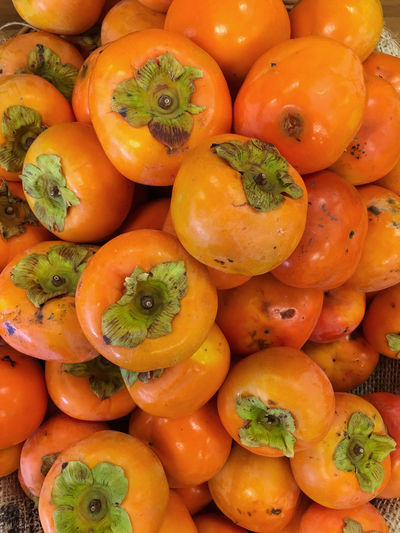 Full frame shot of persimmons for sale at market stall
