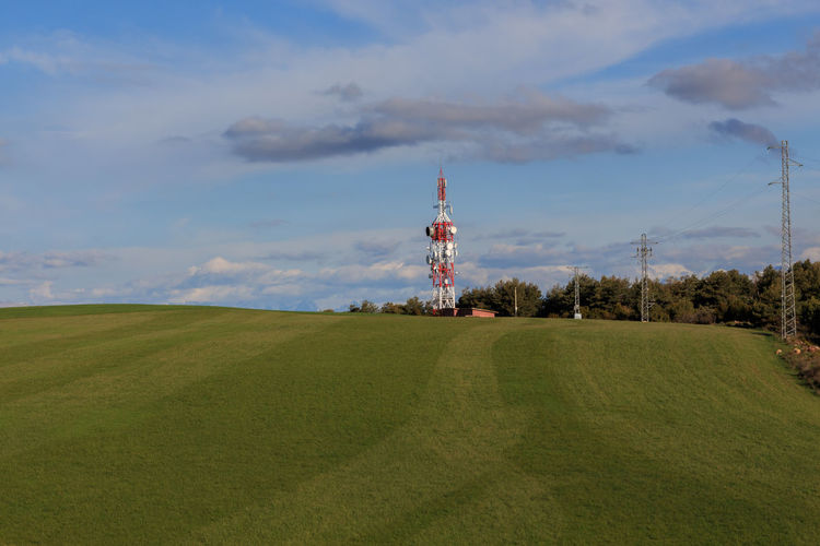 Tower on field against sky
