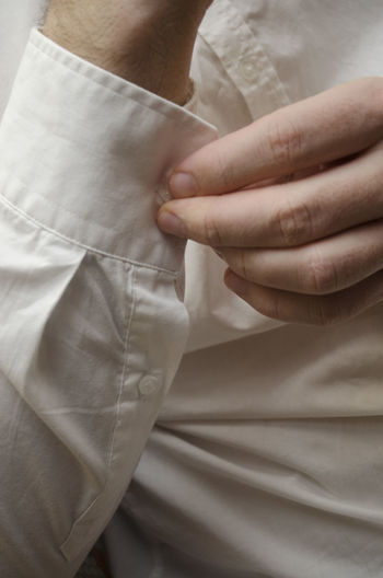 Cropped Image Of Man Fastening Sleeve Button