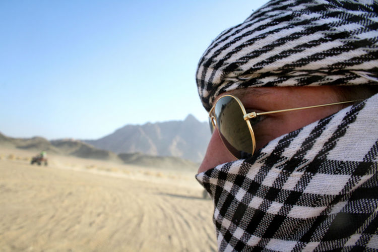Desert Egypt Travel Photography Arid Climate Beauty In Nature Bokeh Clear Sky Close-up Day Depth Of Field Lifestyles Masked Men Nature One Person Outdoors People Portrait Real People Safari Sahara Sky Sunglasses Vacations Young Adult