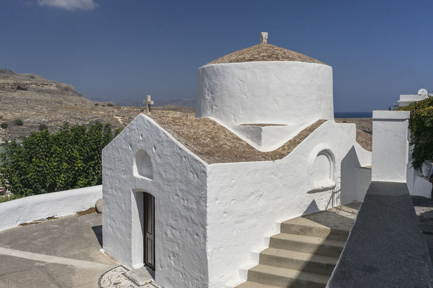 Traditional Greek church overlooking Lindos harbour and beach, Rhodes, Greece Church Lindos, Rhodes Architecture Building Exterior Built Structure Day History Lindos Greece No People Outdoors Whitewashed