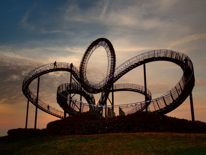Roller Coaster Tiger And Turtle Golf Club Sunset Ferris Wheel Arts Culture And Entertainment Amusement Park Rollercoaster Amusement Park Ride Sky
