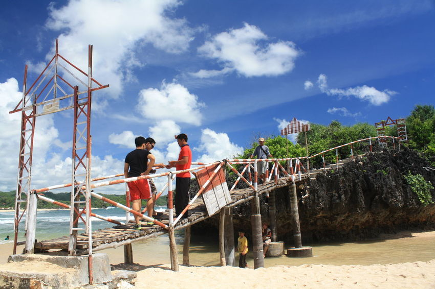 Krakal Beach Adult Adults Only Architecture Bridge - Man Made Structure Built Structure Cloud - Sky Day Full Length Hardhat  Helmet Industry Men Nature Occupation Only Men Outdoors People Protective Workwear Real People Sky Standing Two People Working