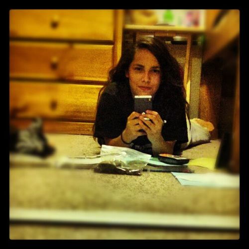 Doing government homework with the homegirl Maritza over the phone..and eating brownies:p lol