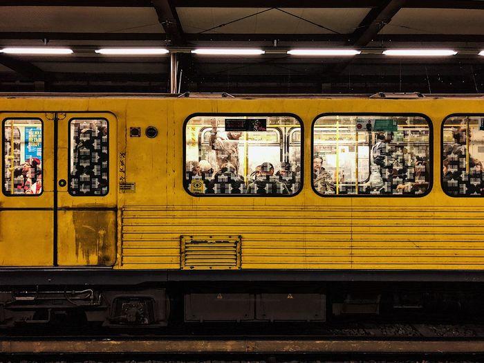 Yellow train at railroad station