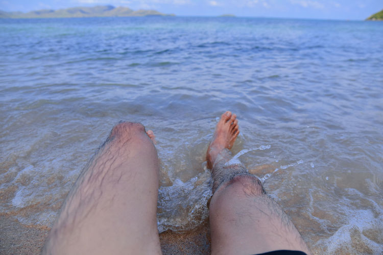Human Leg Water Low Section Human Body Part barefoot Body Part Personal Perspective Real People Sea One Person Lifestyles Relaxation Leisure Activity Human Foot Nature Day Land Beach Outdoors Human Limb Sea And Sky Sea View Sattahip Pattaya Thailand Travel Summer