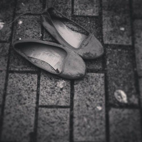 """ Discarded Shoes "" Shoes Discardedshoes Footwear Random Discardeditems Blackandwhite Blackandwhitephotography Bnw Monochrome Monochromatic Pavement Contrast"
