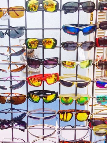 Shades Multi Colored In A Row Variation Vacations Art Is Everywhere Sunglasses No People Choice EyeEm EyeEm Best Shots EyeEmBestPics Iponeonly Helloworld Instamood Smartphonephotography Travel Photography Close-up Turistando Travelphotography carribian Exploring New Ground Exploring Smart Simplicity Pattern Outdoors Live For The Story Summer Exploratorium