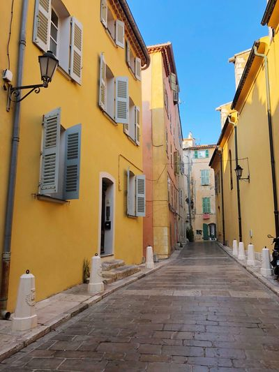 IPhoneography EyeEmNewHere Saint Tropez Street Photography Building Exterior Architecture Built Structure Building The Way Forward Direction City Residential District Window Street No People Narrow Footpath Yellow