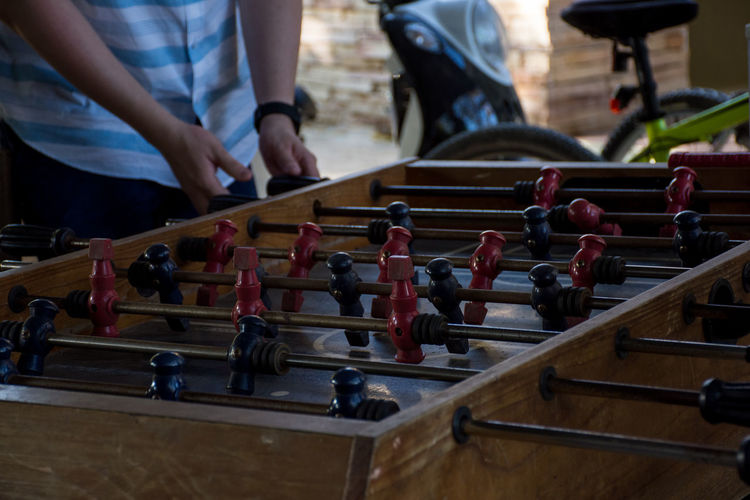 Midsection of man playing foosball