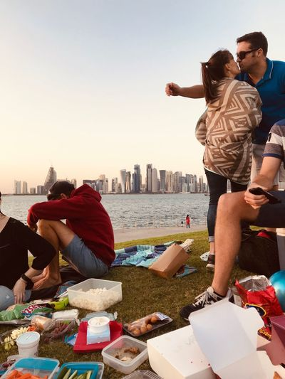 Picnics With People Sky Real People Architecture City Built Structure Leisure Activity Lifestyles Togetherness Sunlight Water Two People Nature Adult Building Exterior Casual Clothing Men Clear Sky Day People Incidental People