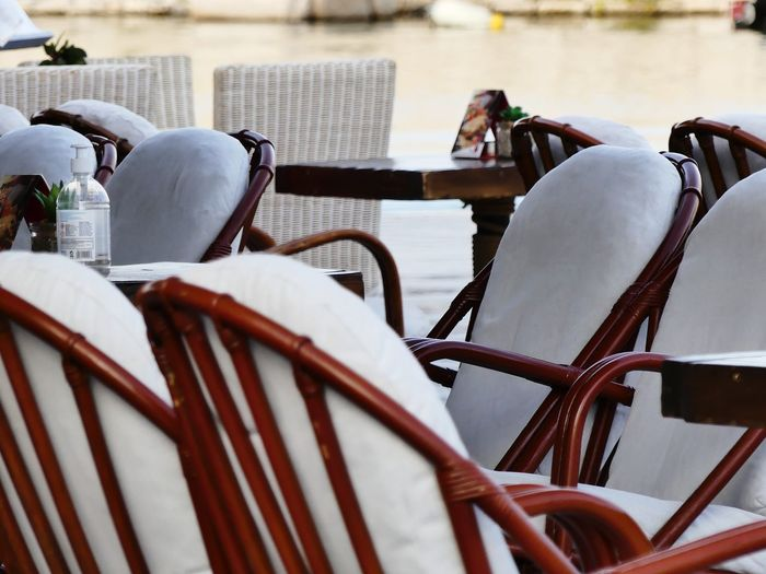Close-up of white chairs