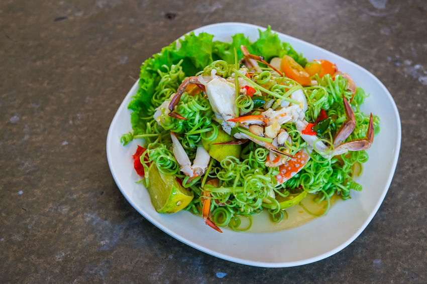 Fresh thai morning glory spicy salad with steamed crabs in white dish, yum Thai traditional food. Crab Food And Drink Spicy Thai Food Spicy Food Spicy Seafood Thai Restaurant Thailand Vegetarian Food Yum Delicious Delicious Food Foodphotography Morning Glory Morning Glory Flower On Table Salad Vegetable Seafood Restaurant Spicy Salad Thai Culture Thai Food Thai Salad Thai Traditional Tomatoes Vegetable Yummy