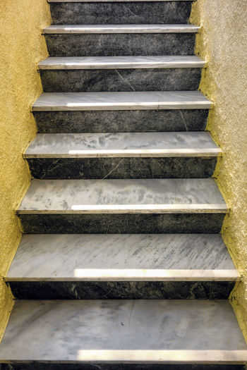 Gray stairs. Forward Stairs Architecture Building Exterior Built Structure Gain Grey And Yellow Grey Stairs No People Outdoors Persistence  Progression  Staircase Steps Steps And Staircases Success To The Goal To The Top Yellow Wall Yellow Walls