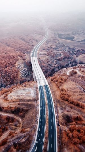 High angle view of winding road in city