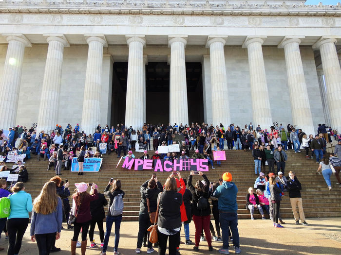 Protesters and signs gathered on the steps of the Lincoln Memorial at the Women's March in Washington, DC. on Saturday, January 20, 2018. Their sign is calling for the impeachment of President Donald Trump. 2018 National Mall, Washington, DC Resistance Washington, D. C. anti-Trump protest architectural column Architecture building exterior day large group of people men outd Impeachment Lincoln Memorial, Washington DC 2018 National Mall, Washington, DC Resistance  Washington, D. C. Anti-Trump Protest Architectural Column Architecture Building Exterior Day Large Group Of People Men Outdoors People Protesters Real People Travel Destinations Women Women's March