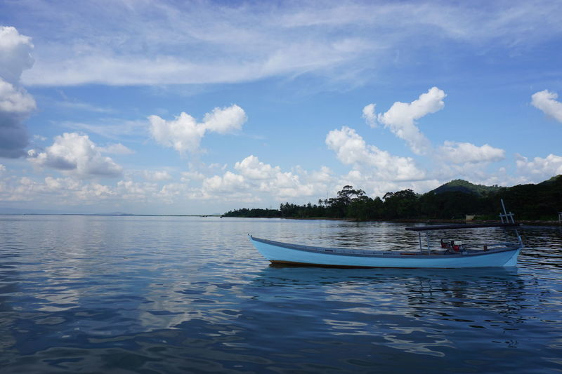 Beauty In Nature Beauty In Nature Blue Blue Boat Boat On Lake Boat On Water Boat On Water In Sunset Calm Water Cloud - Sky Day Horizon Over Water Lake Nature Nautical Vessel No People Outdoors Scenics Sea Sky Tranquil Scene Tranquility Transportation Water Water Reflections Waterfront