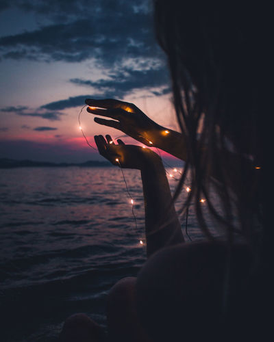 girl sitting in the sea with fairy lights during sunset Tumblr Cute Girl Fairy Lights Hairstyle Holding Nature One Person Real People Retro Styled Sea Sky Sunset Vintage Cars Water Women EyeEmNewHere HUAWEI Photo Award: After Dark