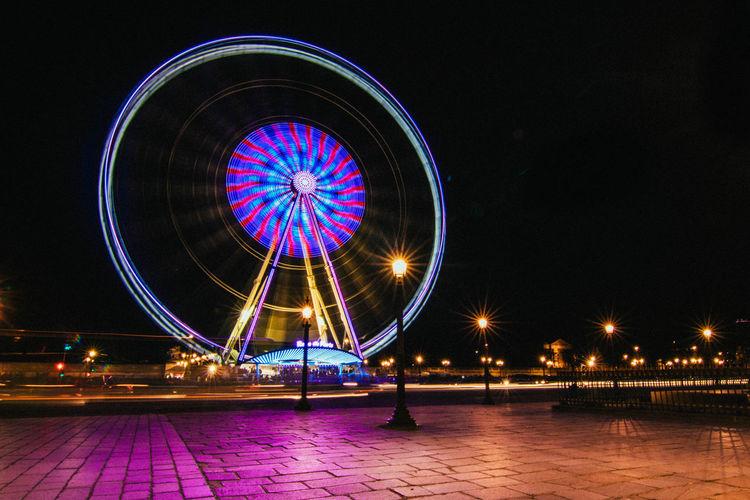 Amusement Park Amusement Park Ride Architecture Big Wheel Ferris Wheel Illuminated Motion Night No People Outdoors Reflection Roue De Paris