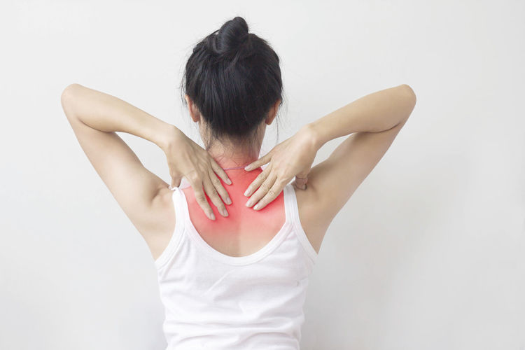 Young woman suffering from neck and medical concepts. Pain Red Shoulder Sign Therapy Ache Black Hair Bone  Chronic  Healthcare And Medicine Human Back Injury Medical Muscles Neck Office Syndrome Painful Physical Sickness Symptom Unwell Workout Young Women