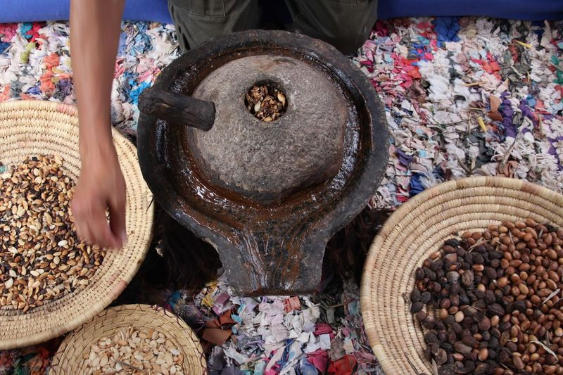 Midsection of man grinding spices
