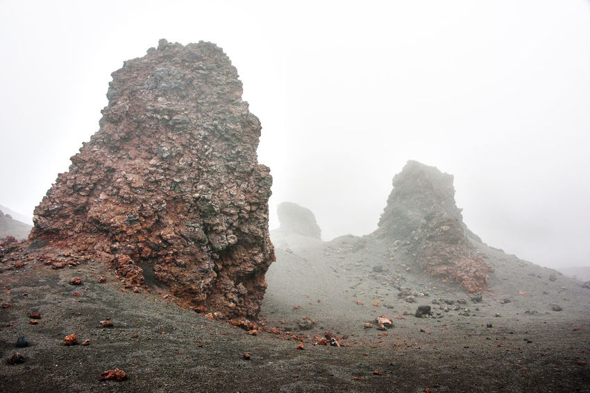 Volcanic desert with standing rocks at Kamchatka Beauty In Nature Day Far East Fog Kamchatka Landscape Mountain Nature No People Outdoors Physical Geography Rock - Object Russia Scenics Sky
