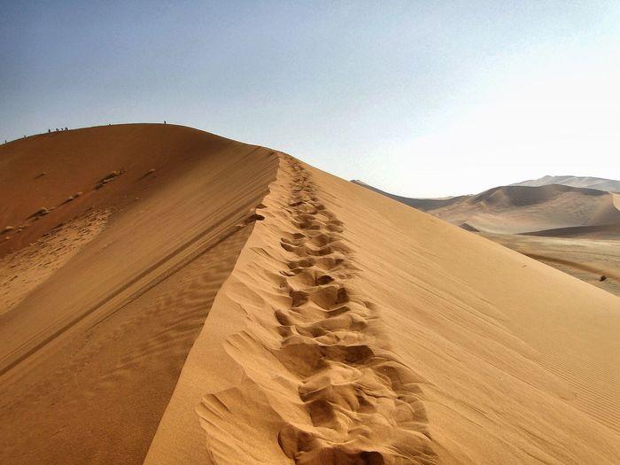 Idyllic shot of sand dune against clear sky at namib desert