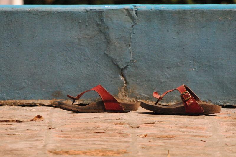 Footwear by wall